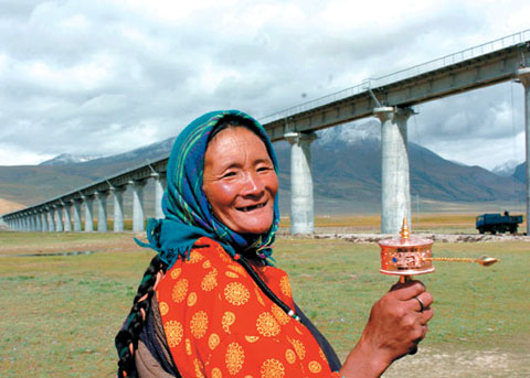An Old Tibetan Lady welcoming the launch of trains, Tibet Train Travel